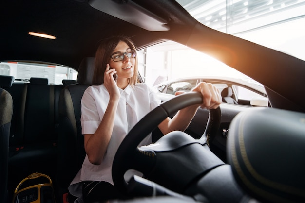 Businesswoman talking on the phone in the car