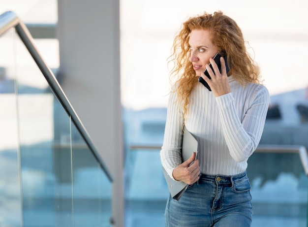 Businesswoman talking on the phone and looking away