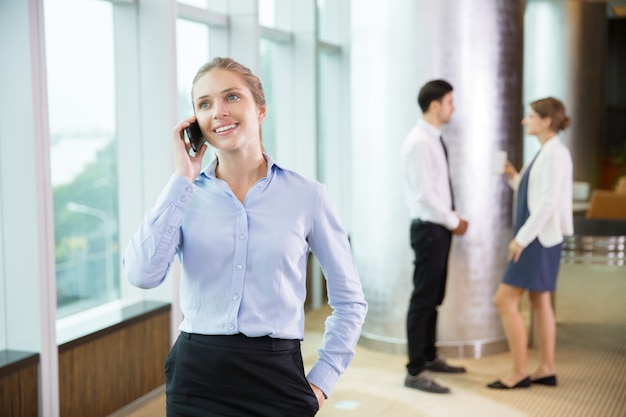 Businesswoman talking on phone in office 6