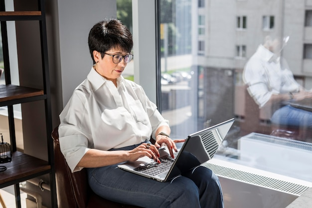 Businesswoman typing on her laptop