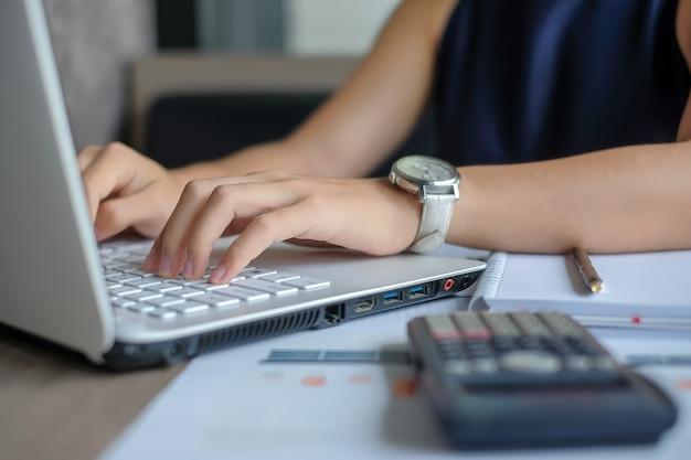 Businesswoman using laptop for analysis maketing plan
