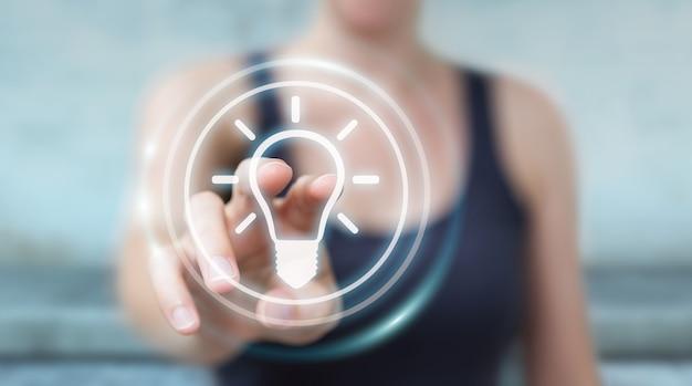 Businesswoman using lightbulb idea interface, 3d rendering