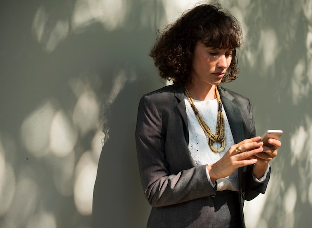 Businesswoman using mobile phone communication technology