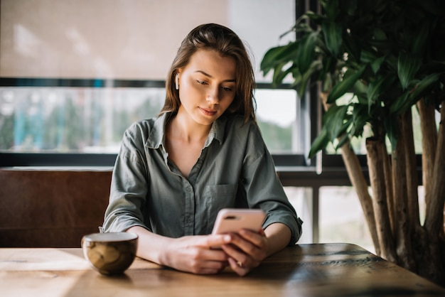 Businesswoman using mobile phone, working from home