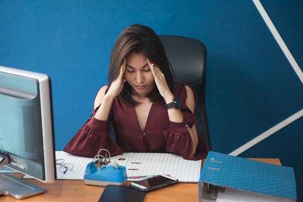 The businesswoman was sick of her headache