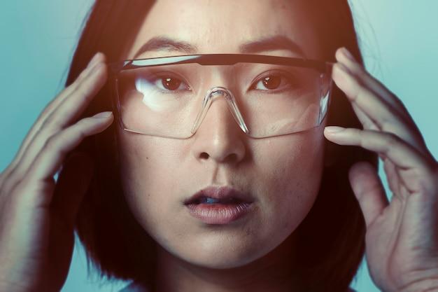 Businesswoman wearing ar glasses, futuristic technology