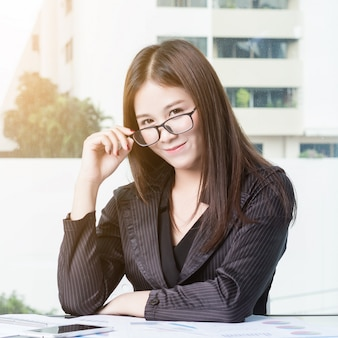 Businesswoman wearing glasses before working.
