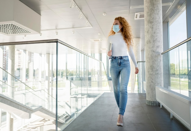 Businesswoman wearing medical mask indoors