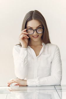 Businesswoman in a white shirt sitting in the office