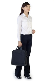 Businesswoman with briefcase, full length portrait of oriental office lady isolated.