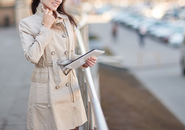 Businesswoman with a digital tablet, standing on the terrace near the business center. people and technology