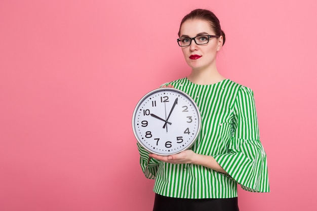 Businesswoman with hair bun and clocks