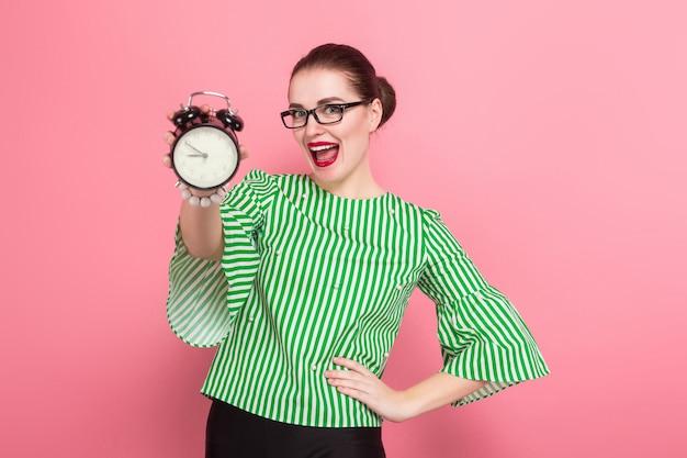 Businesswoman with hair bun and clocks
