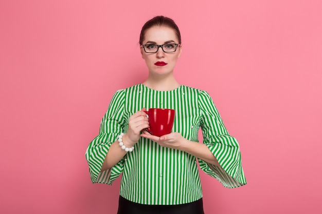 Businesswoman with hair bun and cup