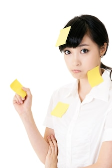 Businesswoman with many yellow memo note on her body