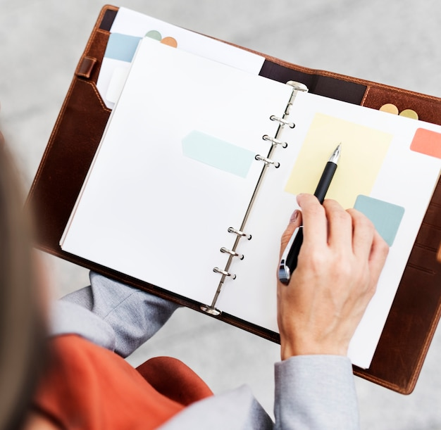 Businesswoman with notebook