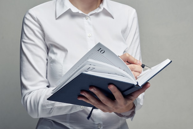 Businesswoman with organizer diary in her hands