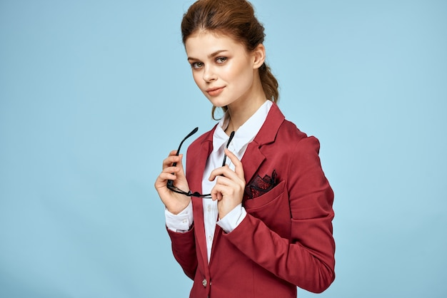 Businesswoman with red jacket and glasses, successful executive woman