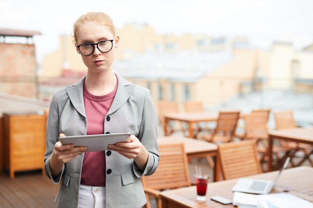 Businesswoman with tablet pc in cafe