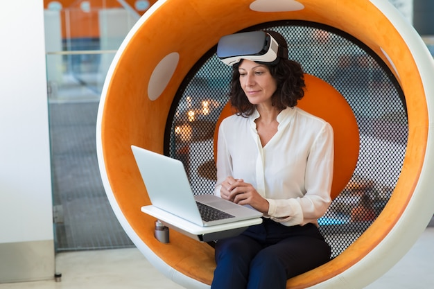 Businesswoman with taken off vr headset