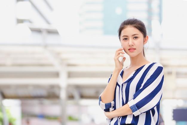Businesswoman worker talking on smartphone