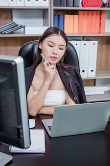 Businesswoman working in the office with a smile while sitting.