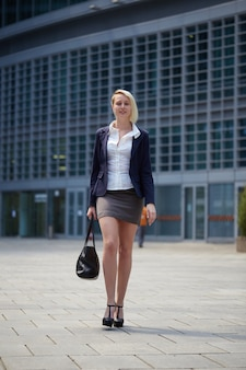 Businesswoman working outside office building