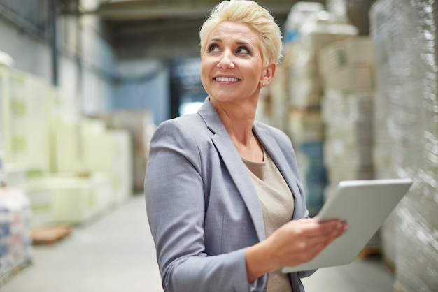 Businesswoman working in warehouse