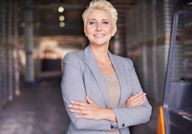 Businesswoman working in warehouse