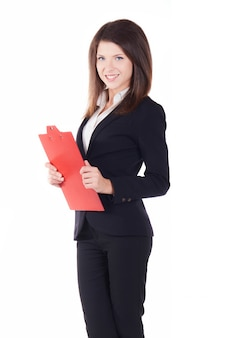 Businesswoman working with clipboard - studio background