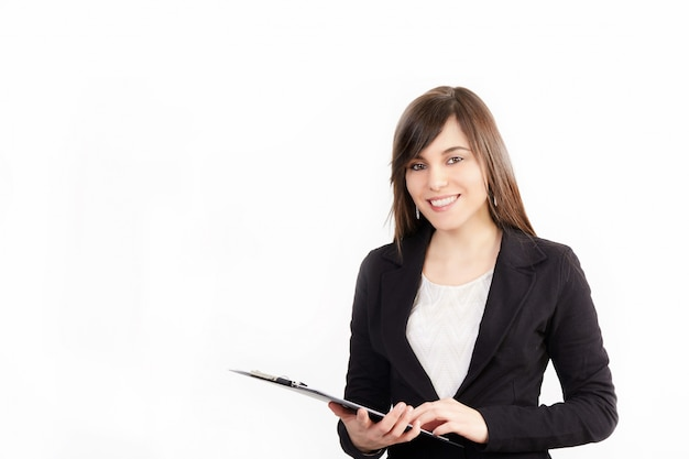Businesswoman working with clipboard - studio background