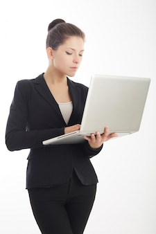 Businesswoman working with laptop - studio background