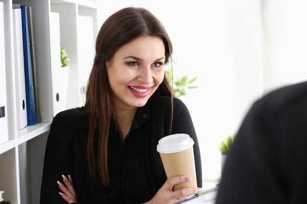 Businesswoman at workplace in office portrait