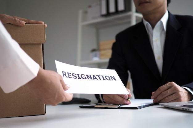 Businesswomen are sending resignation letters to executives.