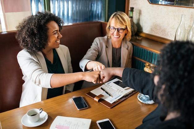 Businesswomen in a fist bump