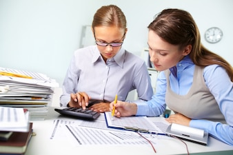 Businesswomen reviewing results