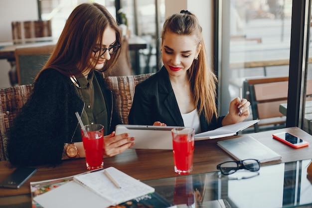 Businesswomen sitting in a cafe