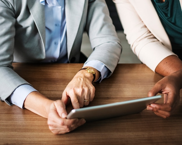 Businesswomen using a digital tablet