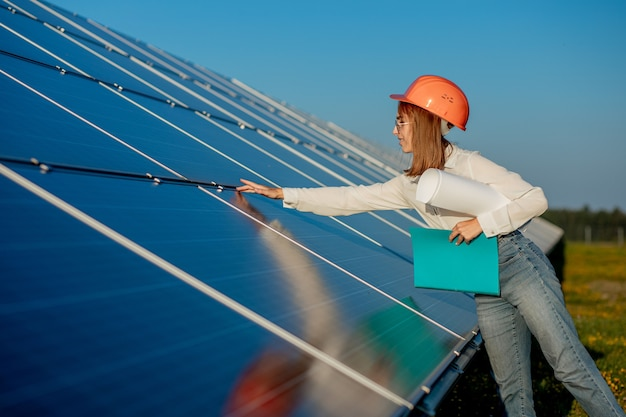 Businesswomen working on checking equipment at solar power plant with tablet checklist