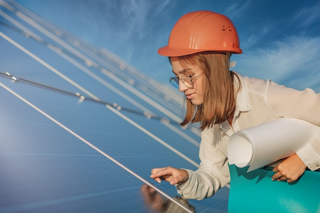 Businesswomen working on checking equipment at solar power plant