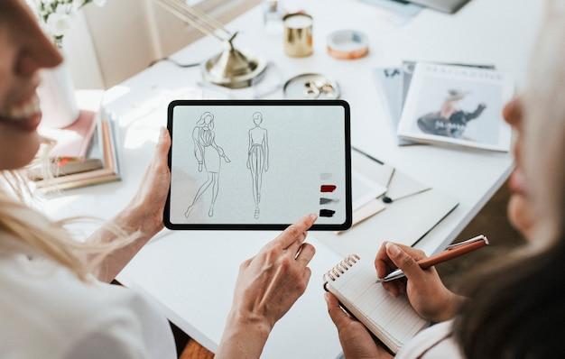 Businesswomen working on fashion clothing design