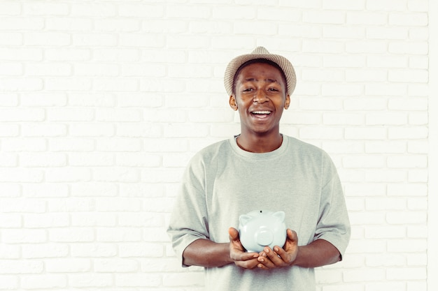 Businness black man with piggy bank
