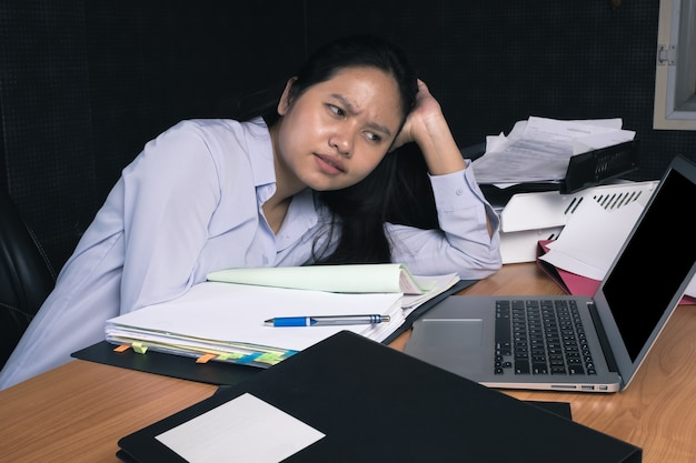 Bussiness woman feeling tired during work at the office