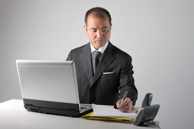 Busy asian businessman