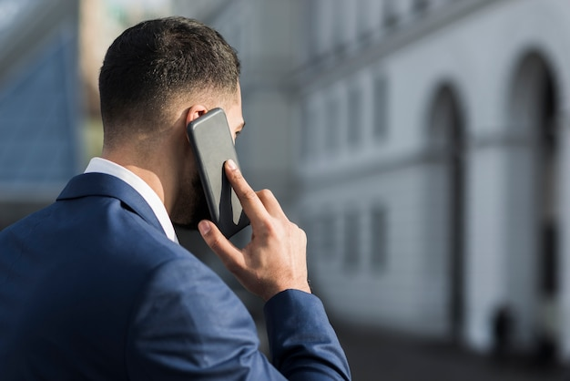 Busy business man talking over phone