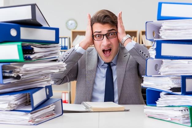 Busy businessman under stress due to excessive work
