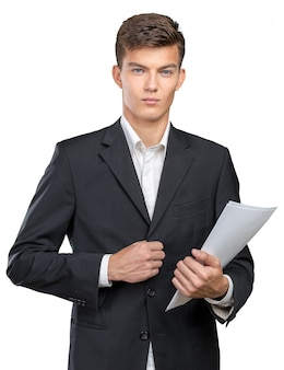 Busy businessman with loads of paperwork