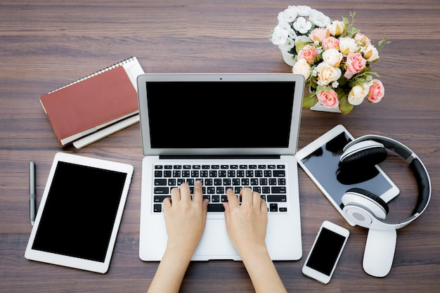 Busy businesswoman with digital devices