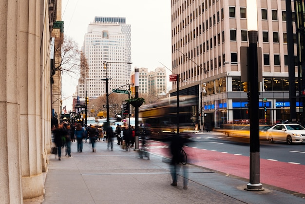 Busy city street with blurred people