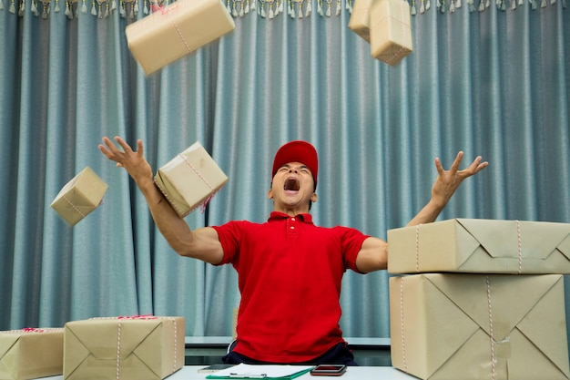 Busy courier in the office and a lot parcels in the air.